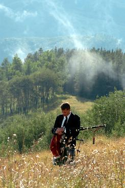 Colorado wedding bagpiper Michael Lancaster piping for a Vail mountain top memorial service, photo by Debbie Malone